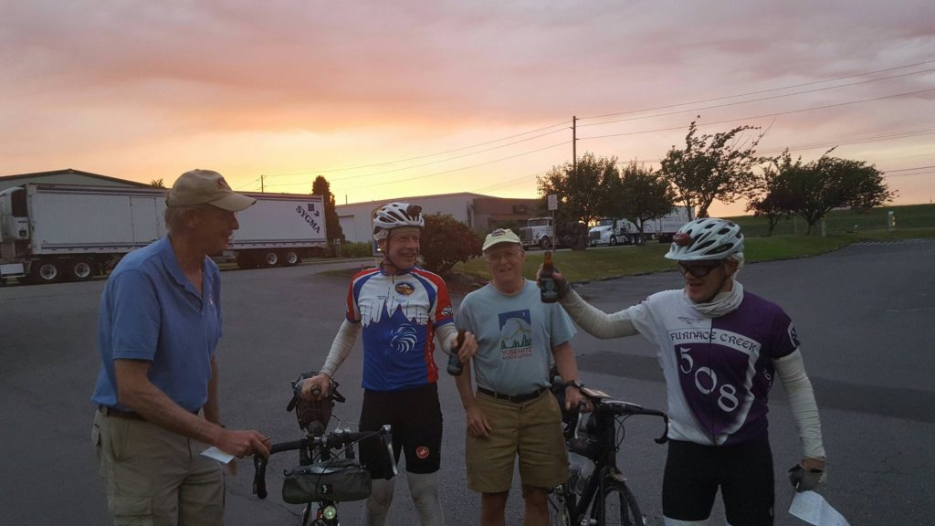 Pre-riders and support at sunset